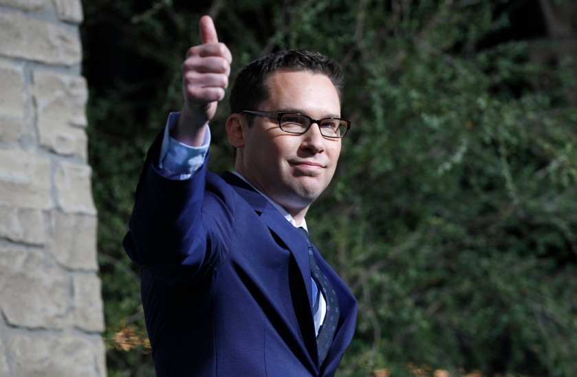 """Director of the movie Bryan Singer gestures at the premiere of """"Jack the Giant Slayer"""" in Hollywood, California February 26, 2013. The movie opens in the U.S. on March 1.  REUTERS/Mario Anzuoni  (UNITED STATES - Tags: ENTERTAINMENT) - RTR3EC3Q"""